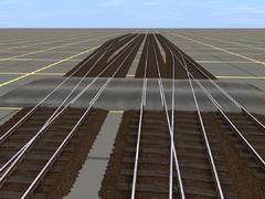 přejezdy s rozličnými osovými vzdálenostmi kolejí a do zhlaví