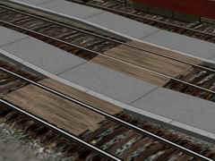 Dřevěné přechody přes koleje.